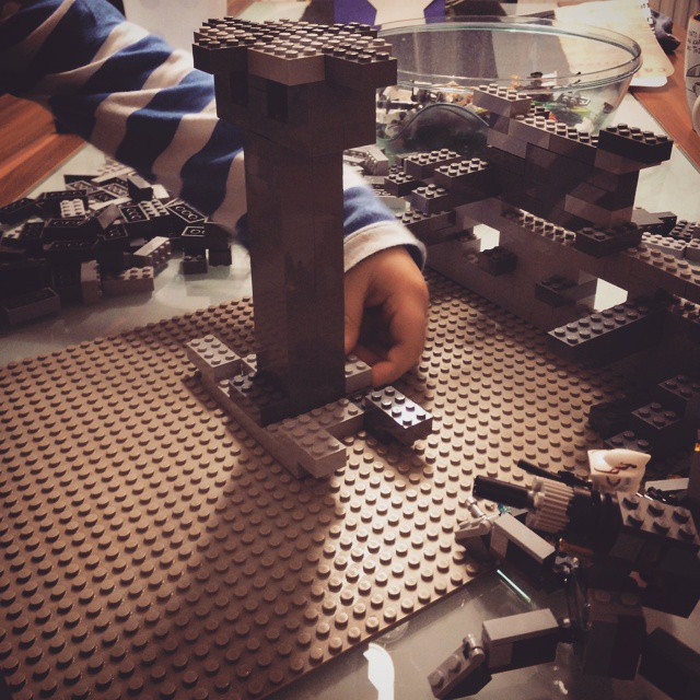 Building a #starwars #lego showcase with my junior. Awesome creative kids mind.